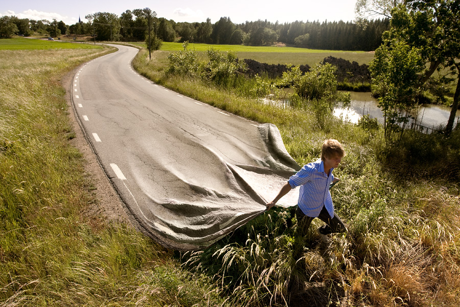 A retouched photo by Erik Johansson, titled Go Your Own Road