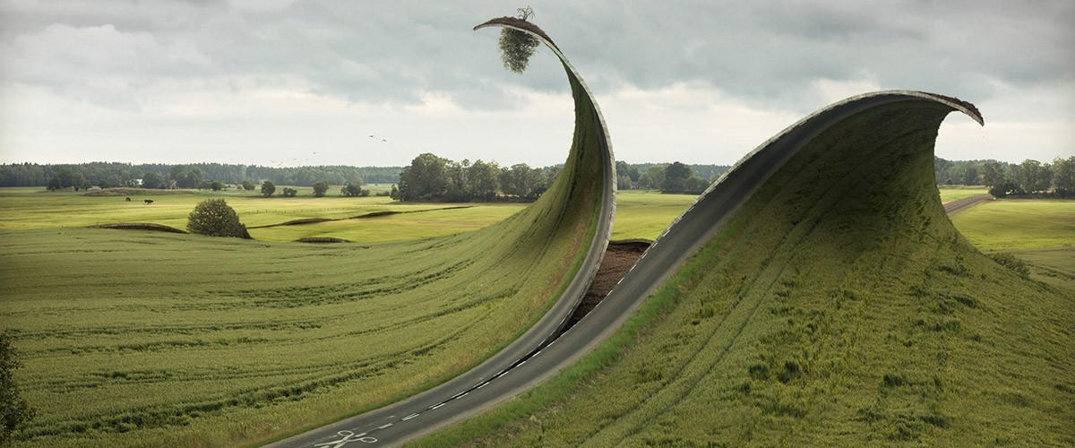 An image by artist Erik Johansson, titled Cut & Fold. It is a retouched photo of a road in Sweden.
