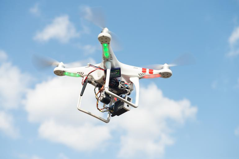 The DJI Phantom helicopter in flight, with a GoPro camera attached.