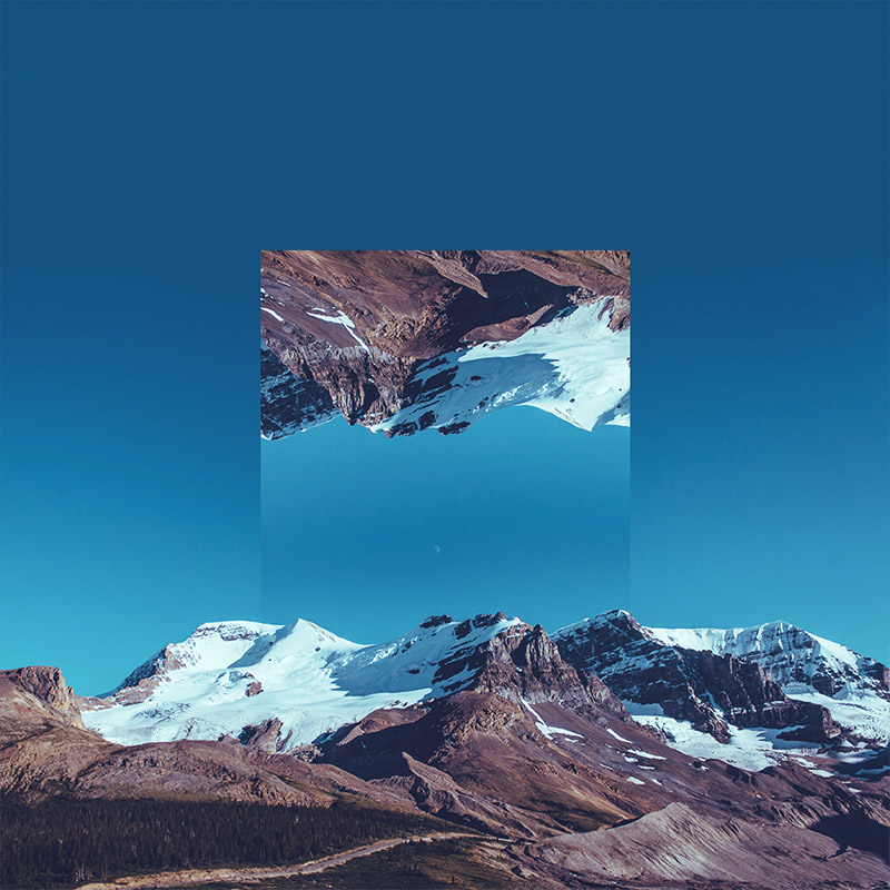 An image by Victoria Siemer, aka Witchoria. It shows a mountain scene reflecting itself.