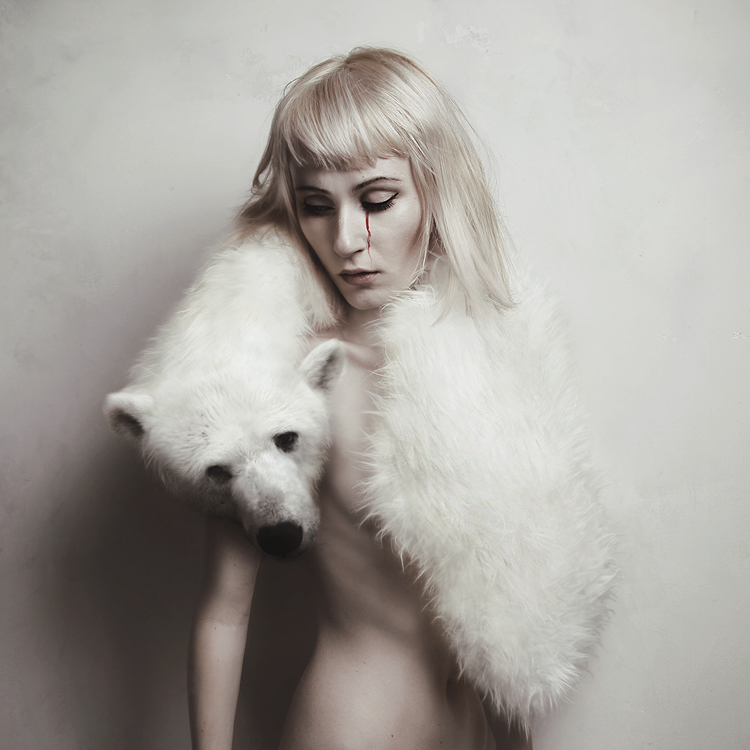 An image of a woman wearing a polar bear stole, by photographer Flora Borsi