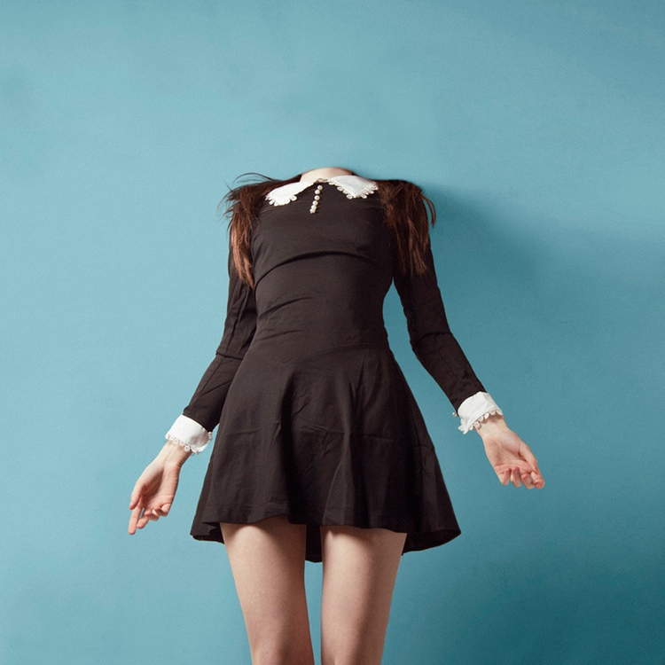 Image of a headless woman, a photo manipulation by photgrapher Flora Borsi
