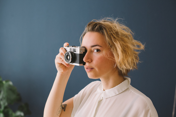 A photo of Julia Nimke holding a camera
