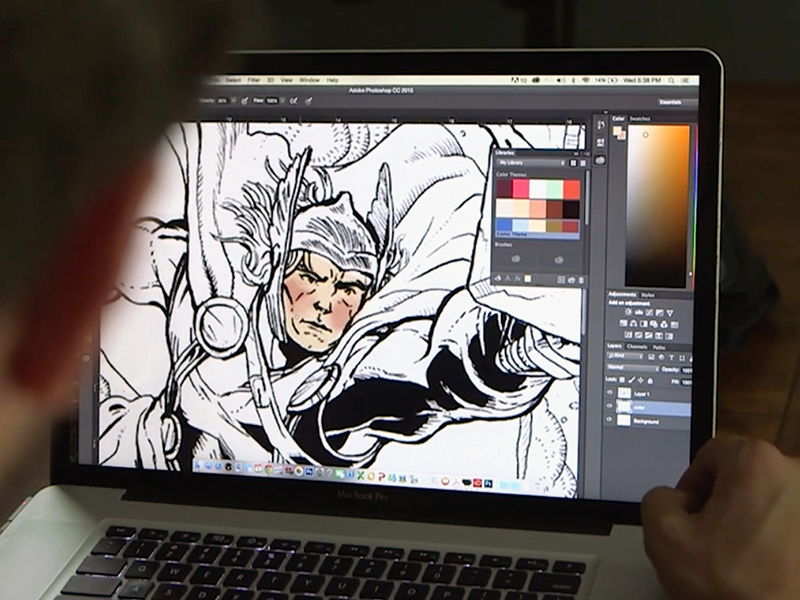 Chad Lewis at work on his Thor art for the