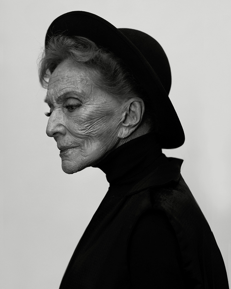 photo of a beautiful older woman in a black hat, by Evelyn Bencicova