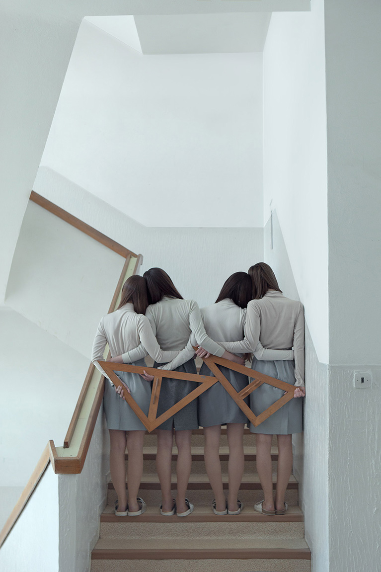 photo of four woman on a staircase,  by Evelyn Bencicova