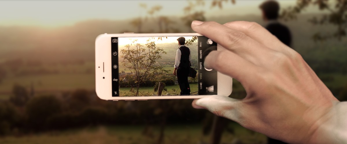 image of a man shooting video with his iPhone