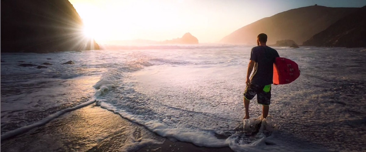 Russell Brown made this surfer photo more dramatic by adding a lens flare.