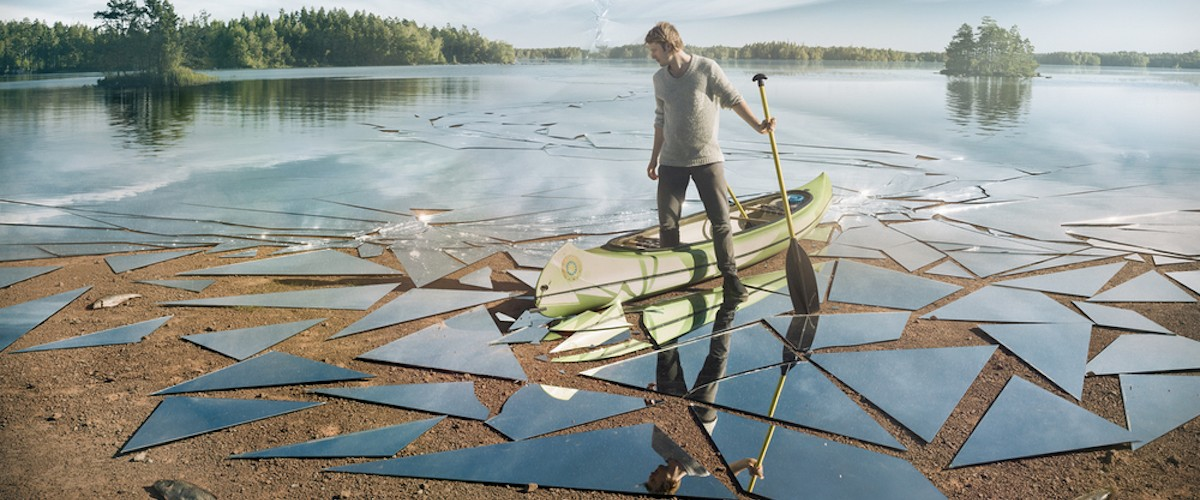 """Impact,"" an image by Eric Johansson (of a man on a mirrored lake)"