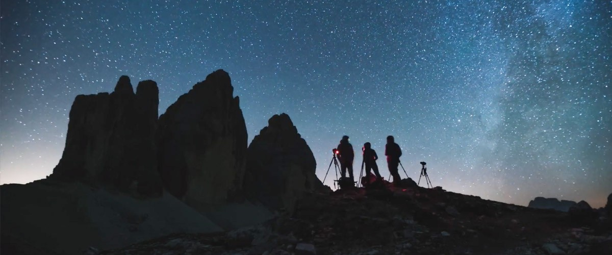 This photo shows Michael Shainblum, Andrew Studer, and Serena Ho capturing images in in northern Italy's Dolomites Mountains.