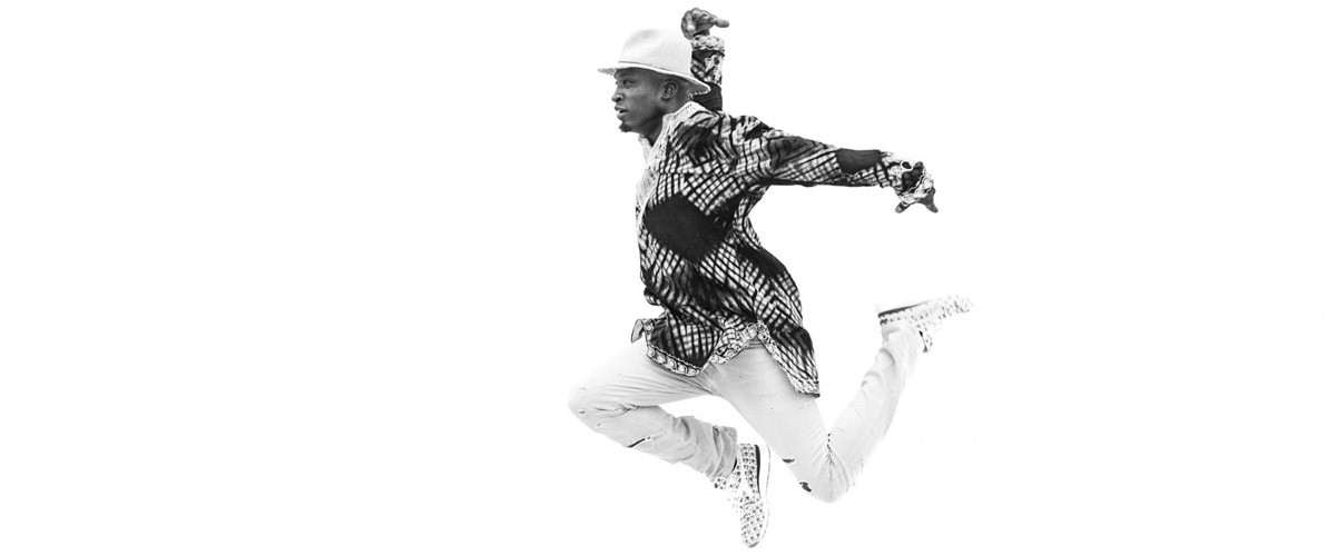 This photo shows the grace and strength of dancer, choreographer, and educator Kwame Shaka Opare.