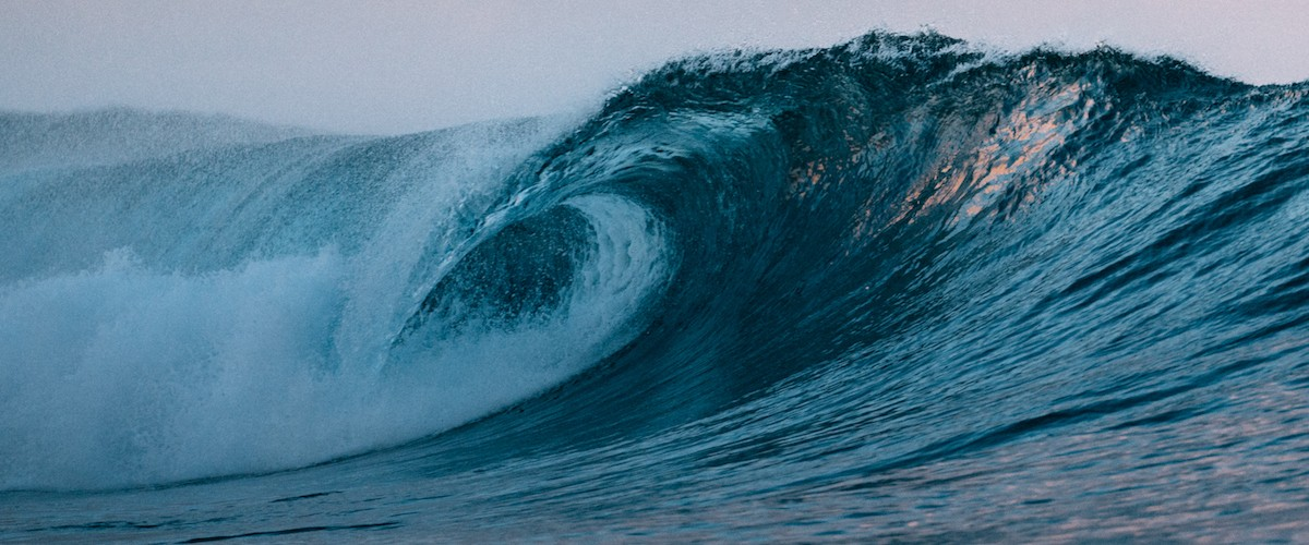 Photo of a wave on a Tahitian beach, by Dan Tom