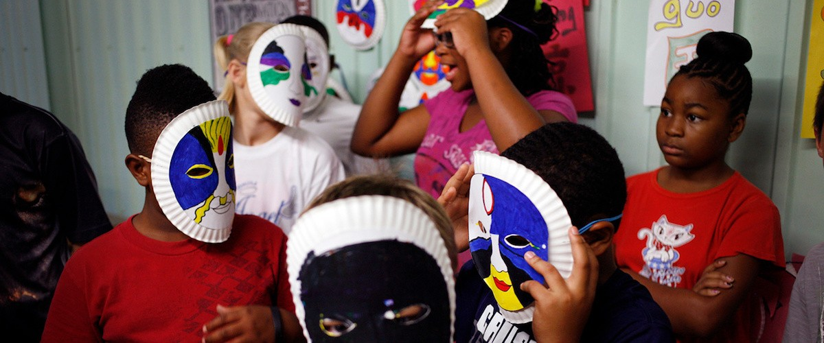 A photo of children wearing masks, by Aundre Larrow