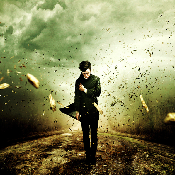 photo composite of a man in a windstorm, by Martin Stranka