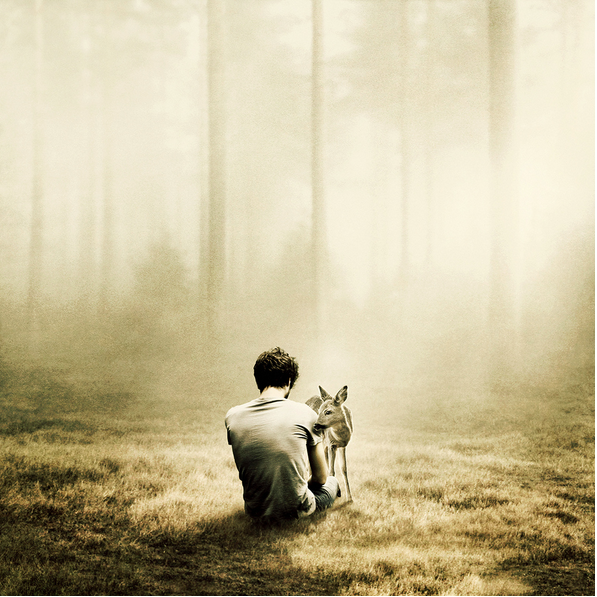 composited image of a man with a deer, by Martin Stranka