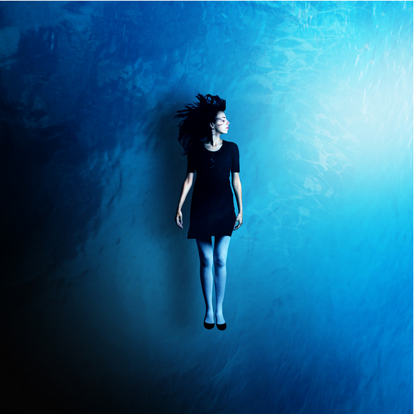 composited image of a floating woman, by Martin Stranka