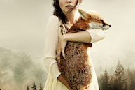 A photo-composite image of a woman holding a fox, by Martin Stranka.