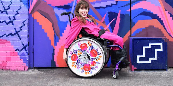 Isabel Keane shows off one of the designs the Irish company Izzy Wheels sells to wheelchairs users who want to make personal fashion statements.