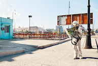 Photo composite of a space suit and a Havana street scene, by Maximilian Motel.