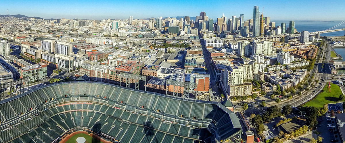 aerial photo of the San Francisco skyline with AT&T Park in the foreground.