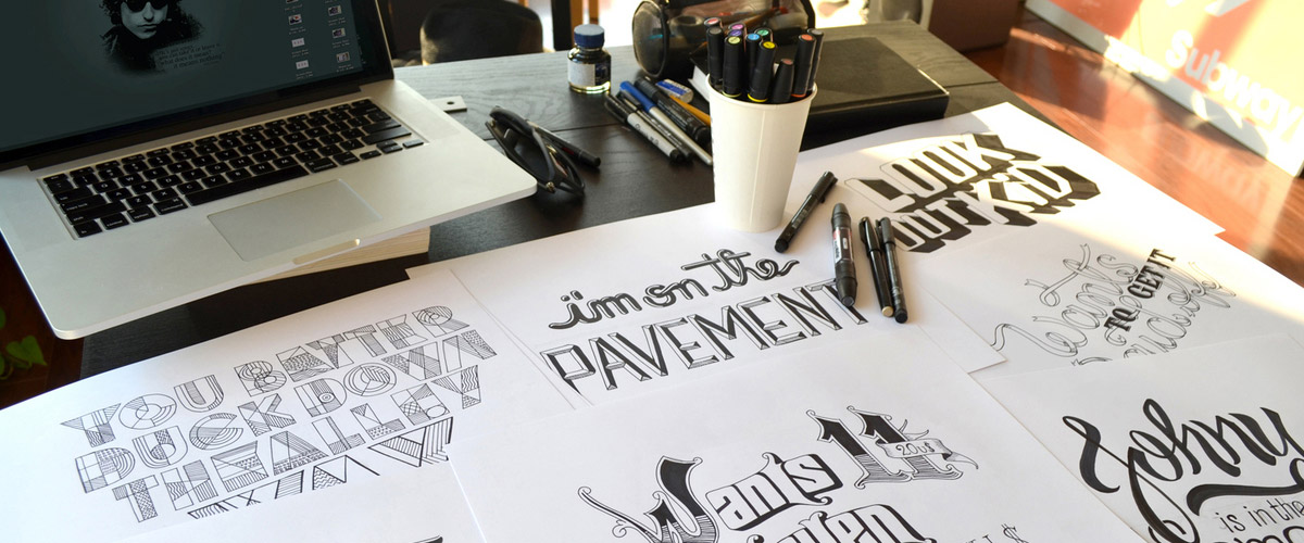 A photograph of lettering work by artist Leandro Senna