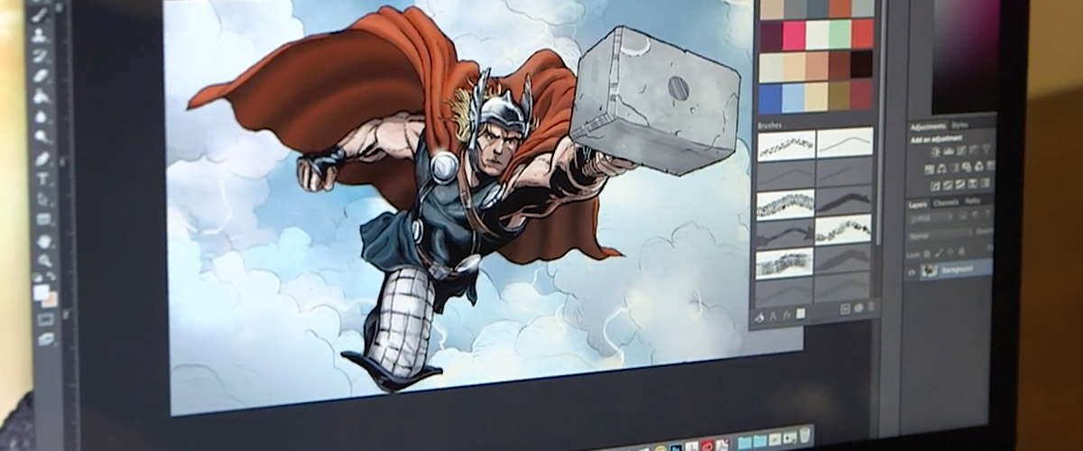 "An in-pocess photo of Chad Lewis working on his Thor art for the Marvel comic book ""Avengers Origins Presented by Adobe #1""."