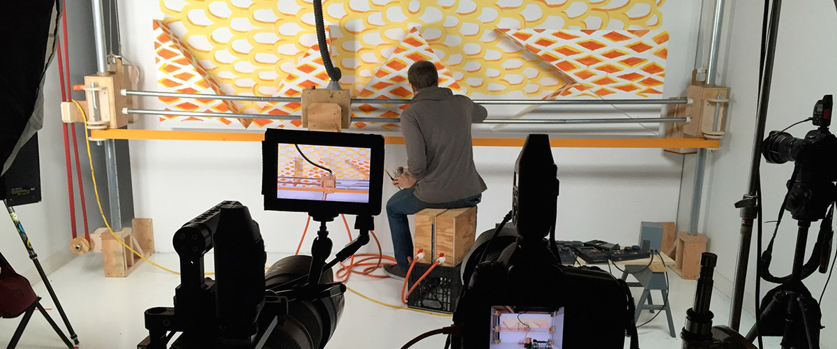 An image of a sculpture of a printing plotter, by artist Kiel Johnson, created for Adobe MAX