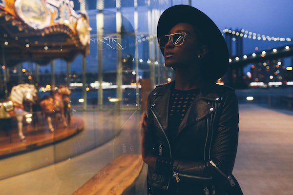 photograph of a woman by a carousel, by Aundre Larrow