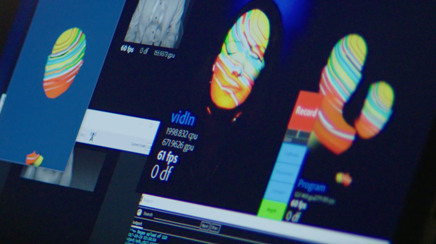 This is a screengrab from a video about the Create Magazine interactive facial-mapping projection experience.