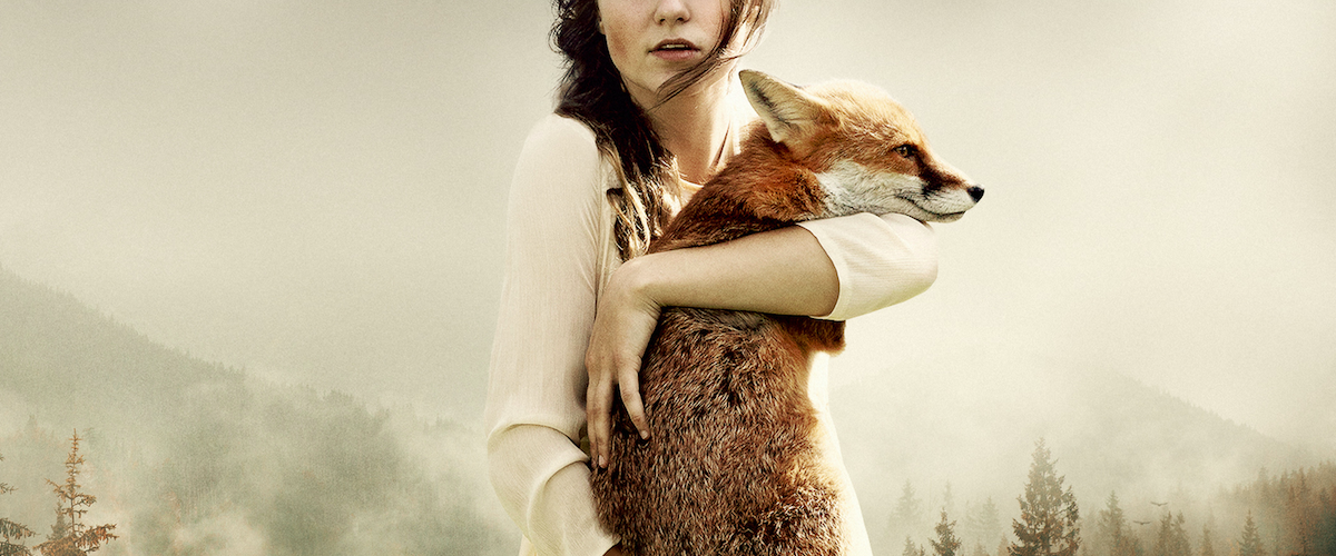 A photo-composit image of a woman holding a fox, by Martin Stranka