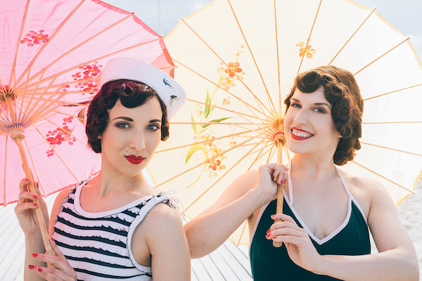 An image of two women with parasols, by Eve Saint-Ramon.