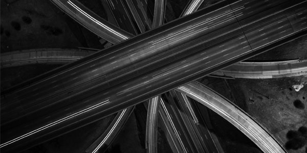 Brian Day shot this photo with an aerial drone and a slow shutter speed, resulting in a striking long-exposure image of a Detroit freeway.