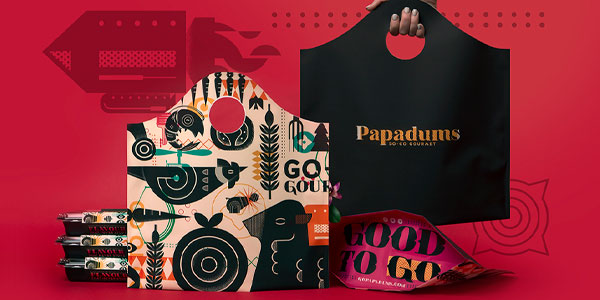 Samples of packages created by Whiskey Design for the food brand Papadums.