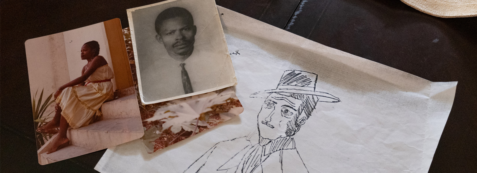 Vintage photos, one of a woman and one of a man,next to pencil sketch of main in hat