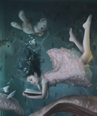 Dreamy surreal image of a girl floating in water, reading a book in her bedroom, which is underwater