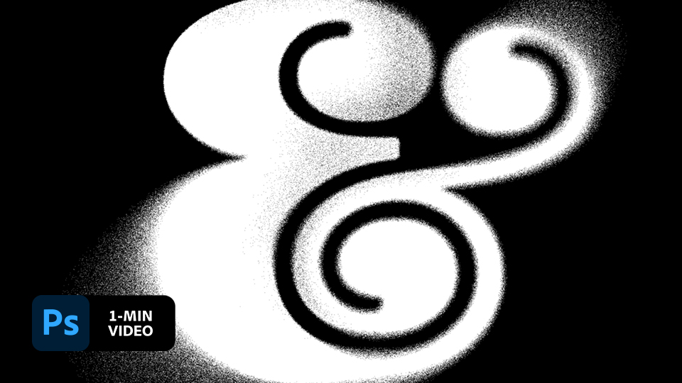 Decorative white ampersand with spray-paint effect applied on a black background and Adobe Photoshop icon in the lower left