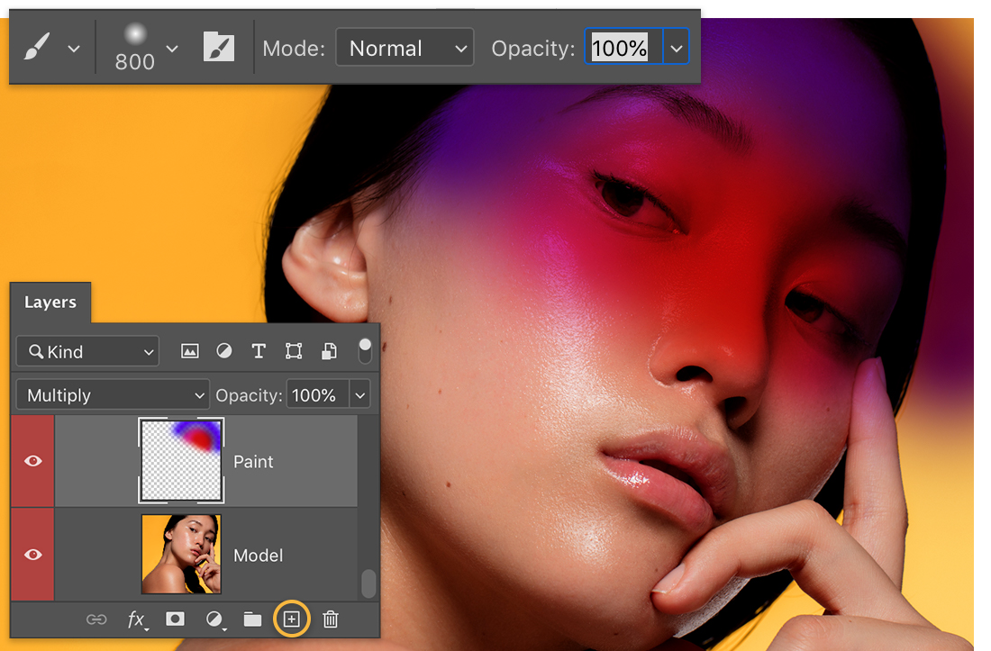 Photoshop Layers panel over headshot of model shows paint layer with custom gradient and soft brush settings set to 800 px
