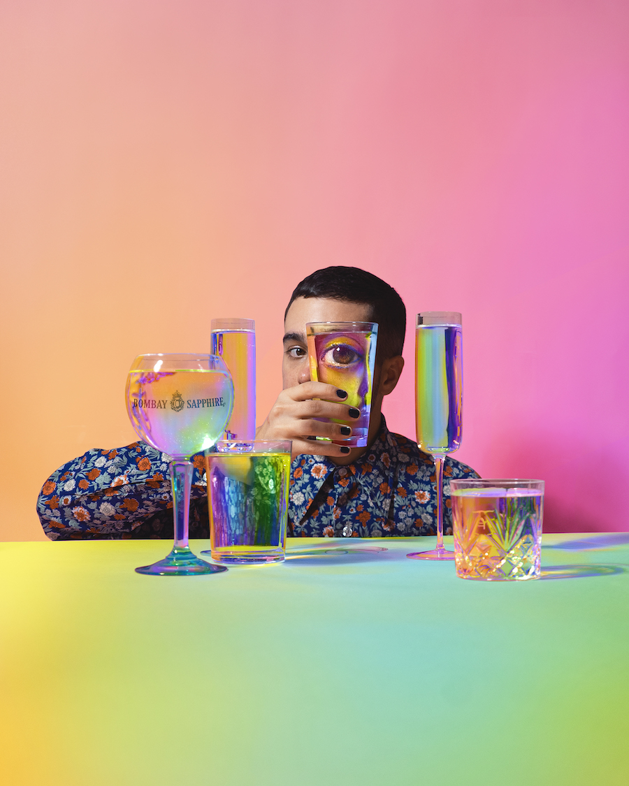 photo of a model and drinking glasses, digitall altered with a pastel rainbow-colored gradient. By Ramzy Masri