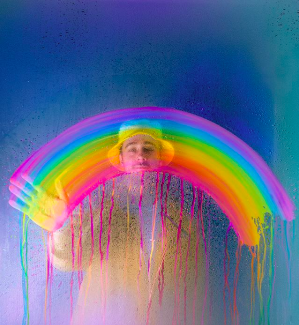 photography of a model in a shower, making a rainbow shape, digitally altered with rainbow colors, by Ramzy Masri