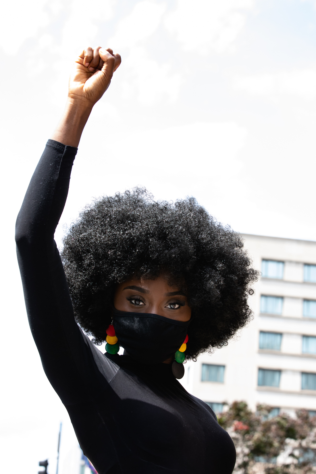 photo of activist with fist raised, photo by Cheriss May